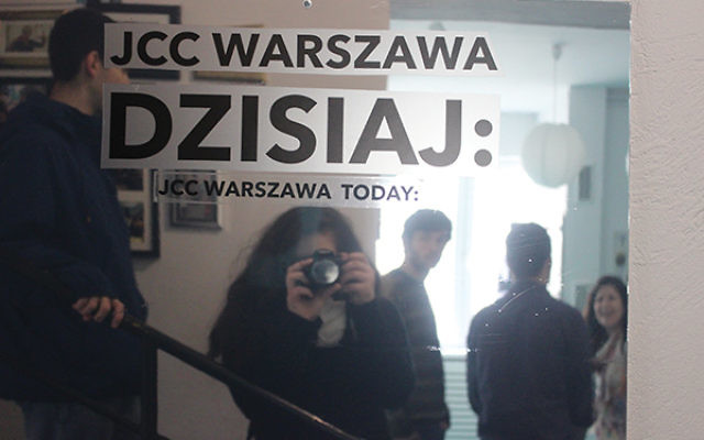 """Sophomore Sarah Spergel, who grew up in Princeton, takes a """"selfie"""" inside the Warsaw JCC, where students went for a meal and the director talked about the role of the center in a city that lost almost all of its Jewish population. Photos by S"""