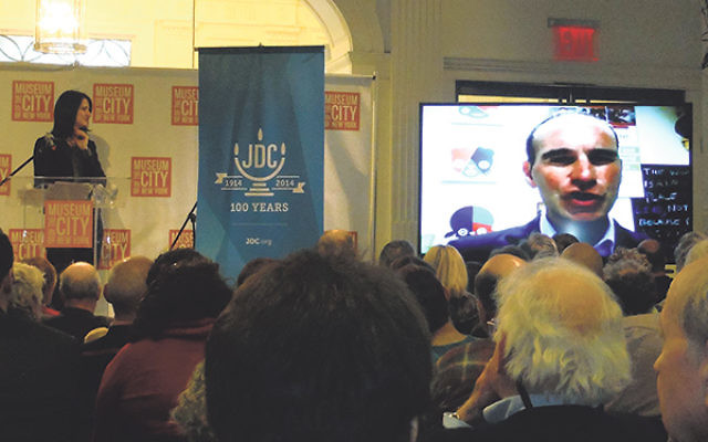 Polish-born Yiddishist Agi Legutko, at the podium, looks on as Cracow JCC executive director Jonathan Ornstein addresses an audience at the Museum of the City of New York.
