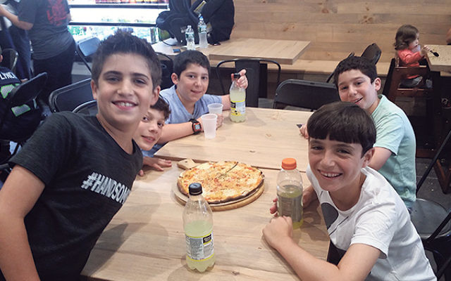 These opening-day customers seem to love the addition of Posh Pizza to the Deal Sephardic Network Community Center in Deal.