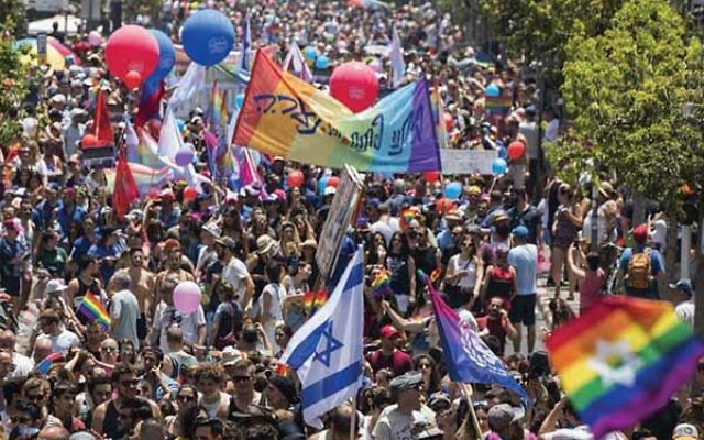 Tens of thousands of celebrants pack the streets of Tel Aviv on June 9 for the annual gay pride parade. JACK GUEZ/AFP/Getty Images