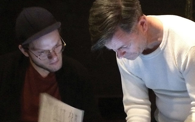 Director Paul Lincoln, on right, confers with music director Brandon Magid before the rehearsal. Photos by Robert Wiener