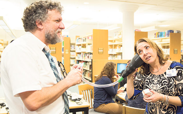 Teachers created innovative sound objects at a Maker-space workshop led by representatives of the New York Hall of Science.
