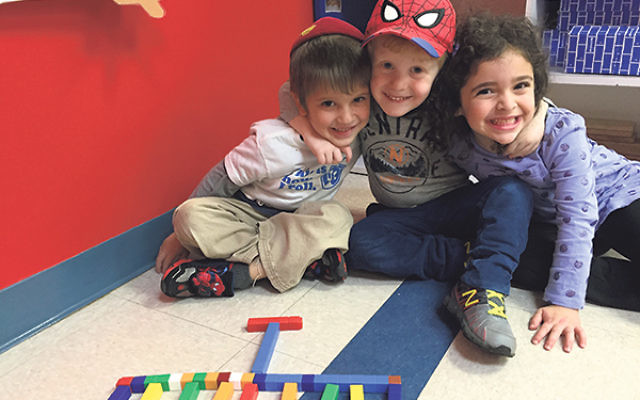 Children in the pre-K class at RPRY celebrate Hanukka by building a menora with blocks.