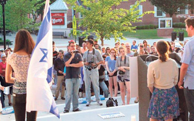 More than 200 students and area residents gathered on the steps of Brower Hall at Rutgers University July 1 to attend a memorial vigil for the three students murdered in Israel.