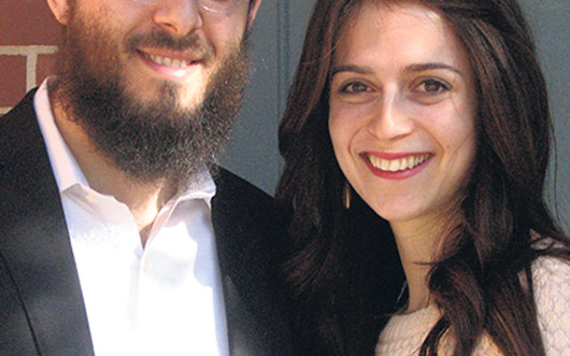 Avremy and Shaina Raksin, outside their Morristown apartment, say they aim to spread happiness through their role at Congregation Ahavath Yisrael.
