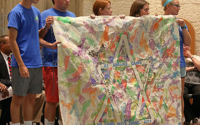 Youngsters from JCC Abrams Camps display a banner at the Israel solidarity rally.