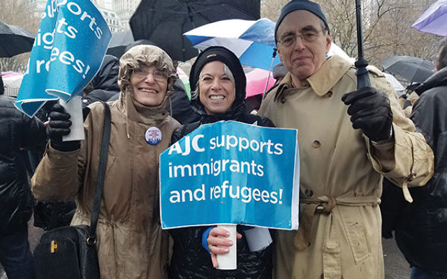 Rally-goers from the American Jewish Committee's Central NJ region, from left, Rysia de Ravel, Lori Feldstein, and Peter Gelb, gather in the rain in Battery Park.