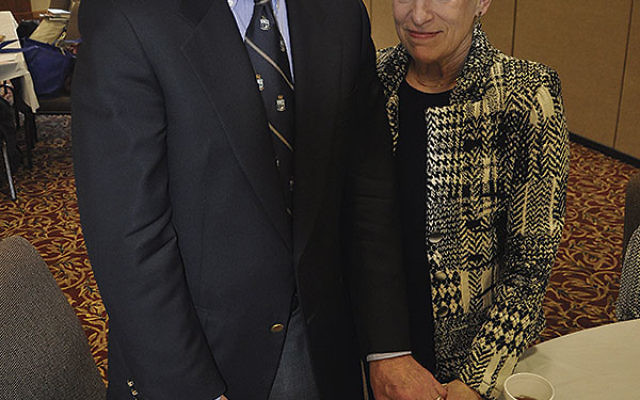 Charles Rojer, with his wife, Marsha Levin-Rojer, told the story of his survival at Kosher Cafe East at Beth El Synagogue in East Windsor.