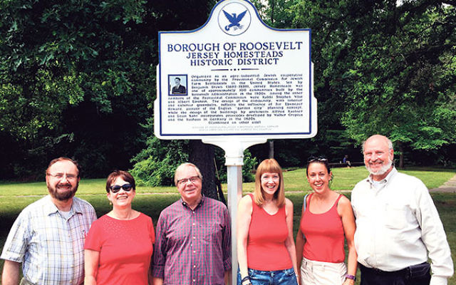 Members of the Roosevelt Borough Council with the newly dedicated historic marker at the town's July 4 celebration, from left, Michael Ticktin, Jill Lipoti, Mayor Jeff Ellentuck, Peggy Malkin, and Stacey Bonna. With them is Jerry Klinger, far right,
