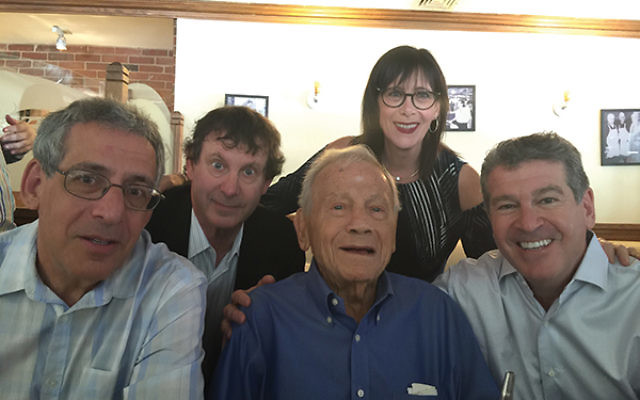 """Max Rosenbach is surrounded by his four children. """"Work, the Jewish community, and family"""" were his priorities, according to son Simon, second from left. From left, Philip, Marsha (Panzer), and David."""