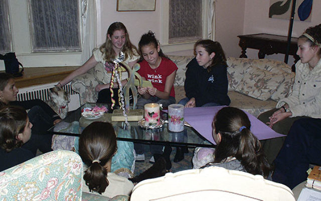 Girls at Rabbi Paula Mack Drill's Rosh Hodesh: It's A Girl Thing group in November 2003. Vered Idan is on the sofa at left.