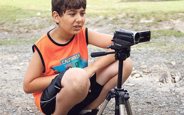 Jake Scherr enjoying a filmmaking elective at Round Lake Camp.