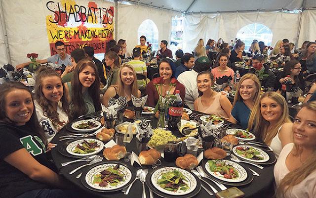 Students began gathering before Shabbat for the traditional dinner at Chabad at Rowan University.