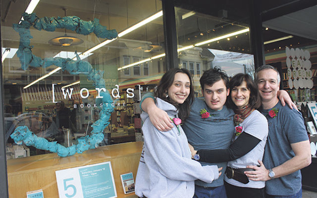 Jonah Zimiles and his wife, Ellen, on right, with their daughter Liz and son Daniel outside the bookstore.