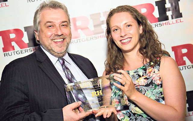 Bethany Mandel is presented with the Young Alumni Award by Rutgers Hillel executive director Andrew Getraer.