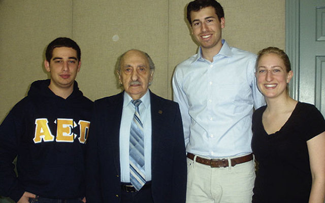 At the Yom Hashoa program at Rutgers are organizers and participants, from left, Adam Nachman of Rho Upsilon, Holocaust survivor David Tuck, Hillel education chair Jeffrey Camras, and Cabaret Theatre director of recruitment and outreach Kate Thomas.