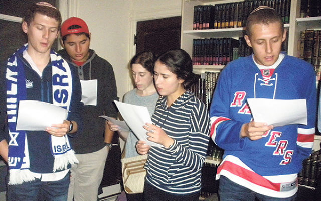 Students at Rutgers Hillel recite tehillim (psalms) for Israel in the wake of recent terrorist attacks.