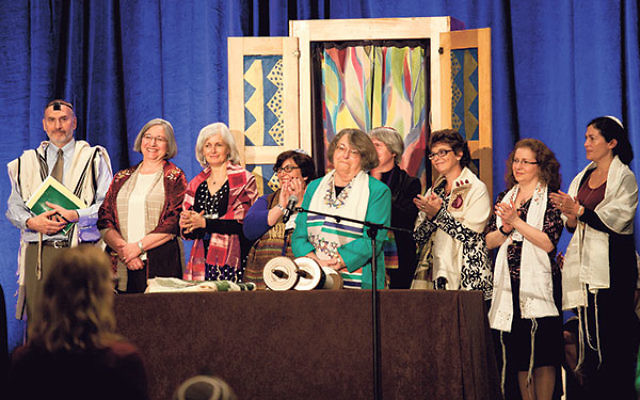 Rabbi Sally Priesand, front and center, is honored with an aliya at the 2012 Central Conference of American Rabbis convention in Boston as she celebrates 40 years since her ordination as a rabbi, surrounded by other women rabbis.