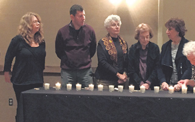 Members of Oheb Shalom Congregation in South Orange lit candles and recited prayers Dec. 3 in the wake of the San Bernardino shooting. The ceremony took place during the second in a series of three programs on gun violence; the film, Living for 32</em