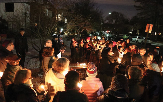Bnai Keshet announced it would offer physical sanctuary to undocumented immigrants at a ceremony that began with a menorah lighting. Photos by Peter Wert