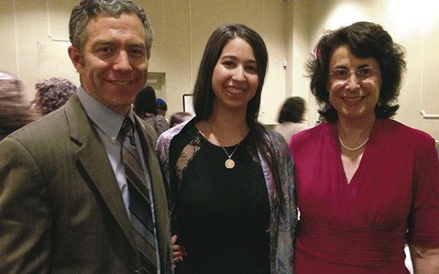 Bat mitzva Sapir Malik, center, with Rabbi Ari Rosenberg and Cantor Amy Daniels at Temple Sha'arey Shalom in Springfield.