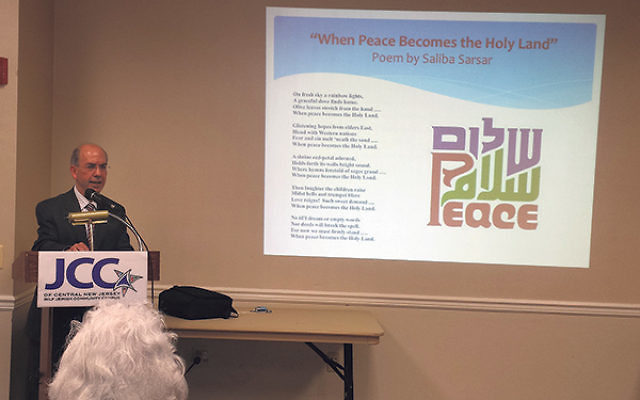 "Speaking at the JCC of Central NJ, Monmouth University professor Saliba Sarsar shares one of his poems about ""peace in the Holy Land."""