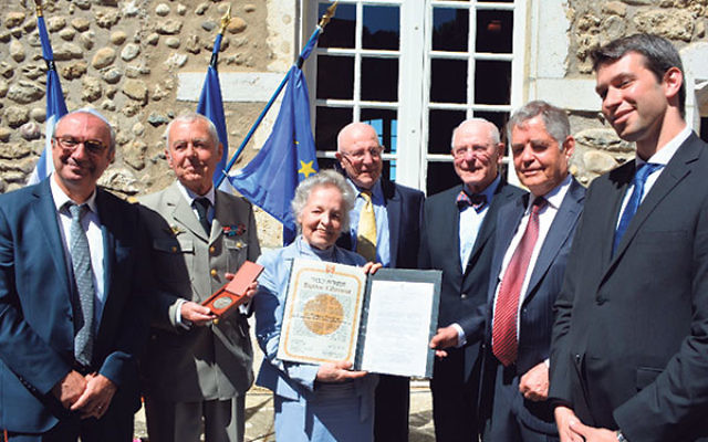 At the July ceremony inducting Count Xavier and Countess Marie-Francoise de Virieu as Righteous Among the Gentiles at Yad Vashem are, from left, Yad Vashem representative Joseph Banon; Antoine de Virieu; Isabelle de Virieu; Bernard and Henry Schanzer; and