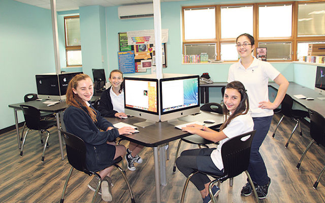 Schechter eighth-graders — including, from left, Kylie Heering, Casey Grafstein, Emily Schwadron, and Elana Bohm — said the rigorous education and support they receive at the school helped them gain acceptance to prestigious high schools with