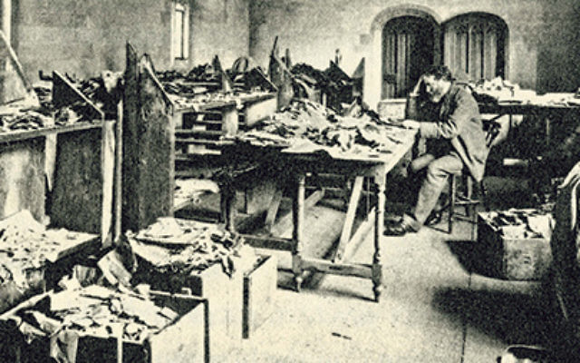 Solomon Schechter at his desk at Cambridge University studying ancient documents from the Cairo Geniza at Ben Ezra Synagogue.