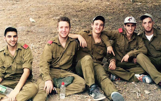 Pictured in center is the late Ezra Schwartz, an American yeshiva student killed by a Palestinian terror attack on Nov. 19.