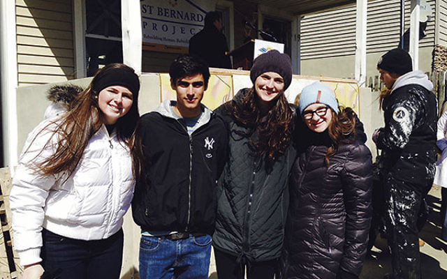 Four Sandy Teen Fellows turned out for the March 26 launch of Sea Bright Rising's campaign to rebuild several houses damaged by Hurricane Sandy, from left, Clara Eskwitt, Ben Cooper, Hannah Stamer and Katie Eskwitt.