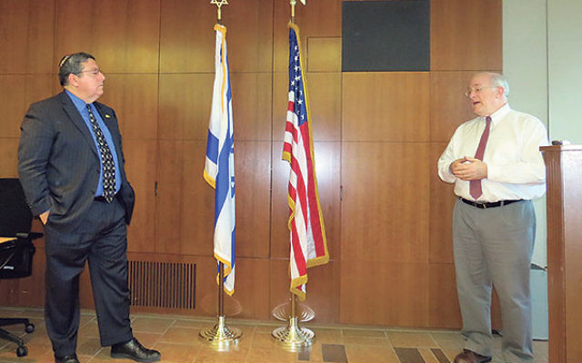 Daniel Kurtzer, right, a Princeton University professor and former ambassador to Egypt and Israel, discusses the murders of three Israeli teenagers, with Mark Levenson, chair of the NJ State Association of Jewish Federations and a partner at Sills Cummis