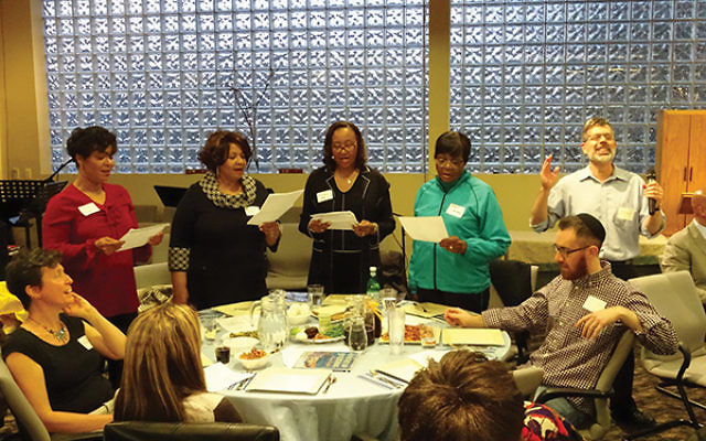 "Congregation Beth Hatikvah Cantor Steve Wetter leads members of Fountain Baptist Church in singing, ""Hinei ma tov u'manayim."" Photos by Robert Wiener"