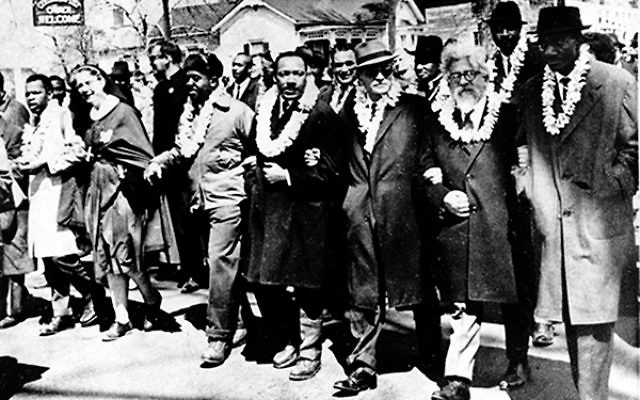 Rabbi Abraham Joshua Heschel, second from right, marches at Selma with Martin Luther King Jr. and other civil rights leaders.