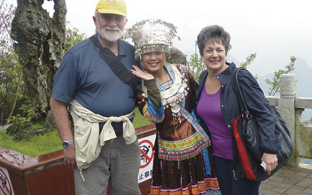 The Zelinghers with a member of a Chinese minority group at the top of Yao Mountain outside of Guilin, China. They reached the summit of this 3,000-foot mountain by cablecar.