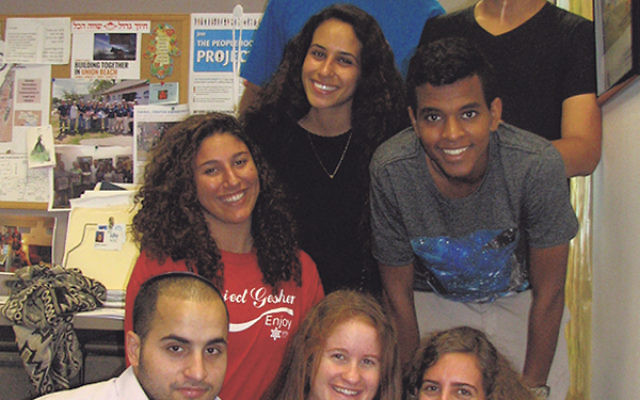 Israeli rishonim and shlihim — educational and cultural ambassadors in Greater MetroWest — gather on the Aidekman campus, from left, bottom row, Maor Tirry, Roni Kollender, and Eli Goren; middle row, Ligal Peretz, Yuval Dafad