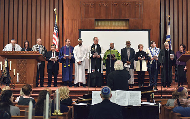 Faith leaders take part in the May 1 Interfaith Holocaust Remembrance service at Oheb Shalom Congregation.