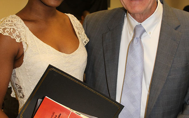 Princeton High School student Jamaica Ponder received an Upstander Award from Lawrence Glaser, executive director of the NJ Commission on Holocaust Education.