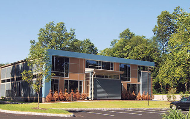 """Temple Sholom's new premises on Lake Avenue is one of the """"greenest"""" synagogue designs in the region, with a permeable-surface parking lot and an adaptable layout."""