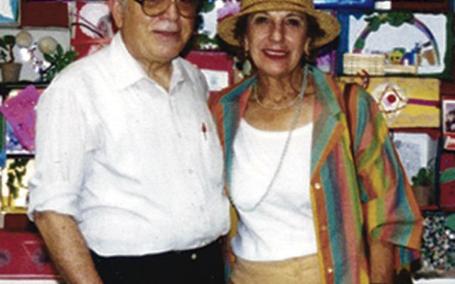 Rabbi Joseph Maza and his wife, Shirley, in 1996 by a bulletin board at Congregation Anshe Emeth celebrating the 3,000th anniversary of Jerusalem.