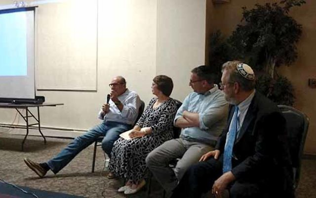 """Tel Aviv native Eilan Ezrachie, far left, said that as a 14-year-old boy during the Six-Day War there was an atmosphere of """"anxiety and fear"""" that was replaced by """"euphoria"""" by the fourth day. Joining him on the panel were, from le"""
