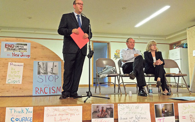 At the July 6 interfaith rally in Highland Park, Rabbi Philip Bazeley said that solitary confinement violates the Jewish religious tradition requiring that everyone be treated with respect. Looking on are State Sen. Raymond Lesniak and Assemblymember Nanc
