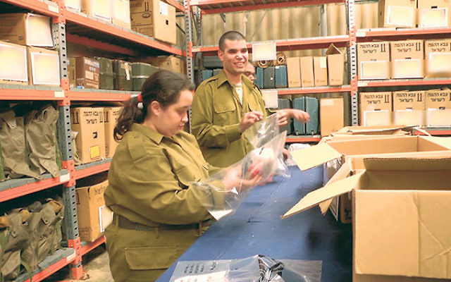 Special in Uniform IDF soldiers prepare packets of medical supplies for an Israeli field hospital.