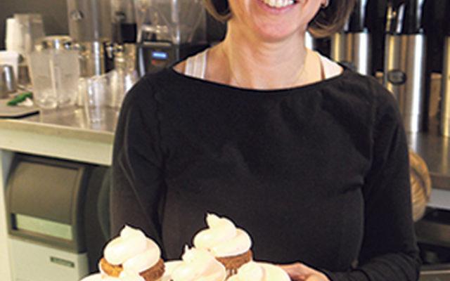 Owner Michelle Retik displays her grain-free cupcakes.