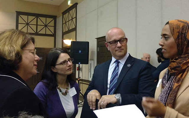 """Steven Gutkin, deputy director of the state Office of Homeland Security and Preparedness, said New Jersey's diversity is a strength """"when we are united as a community""""; with him are, from left, state Sen. Linda Greenstein; Rabbi Esther R"""