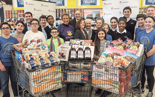 Local officials, clergy, and school children joined Stop & Shop representatives at the store on Valley Street in South Orange to celebrate the donation of one ton of kosher-for-Passover food to the Bobrow Kosher Food Pantry.