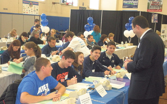 At the Wilf campus in Scotch Plains, federation CEO Dov Ben-Shimon encourages teen Super Sunday phone callers, from left, Ada and Brett Mayerson, Michelle and Jason Telse, and Ethan Finver.