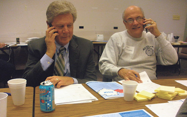 Rep. Frank Pallone, left, is joined by federation campaign chair Jeffrey Schwartz in making phone calls on Super Sunday.