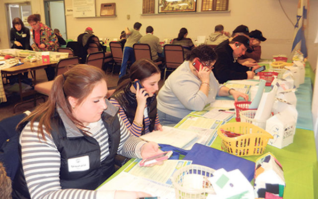 Volunteers make calls at Middlesex Super Sunday last year at federation offices in South River.