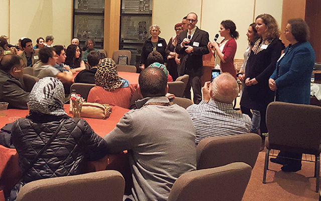 """Rabbi Elliott Tepperman and other community leaders welcome the Syrian families to Bnai Keshet. """"It only happened,"""" he said, """"because good people kept saying we have to do something."""""""